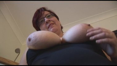 Busty mature BBW in mini dress showing off big round ass