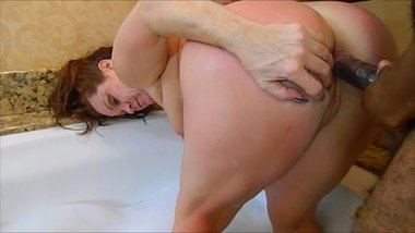 Redhead Milf takes BBC in the Ass in the Bathtub