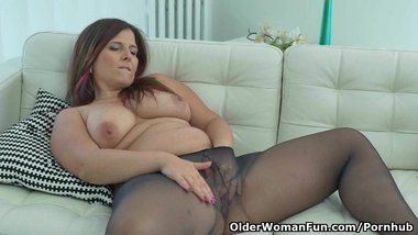 European milf Riona exposes her womanly curves in nylon pantyhose