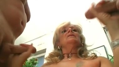 ugly Blonde mature whore knows how to handle to big cocks at the same time1
