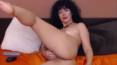 Awesome milf with curly hair masturbating