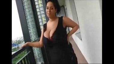 Big natural boobs on balcony